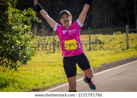 CAXIAS DO SUL, RS, BRAZIL - JULY 08, 2018: Woman doing funny pose during marathon #1131791786