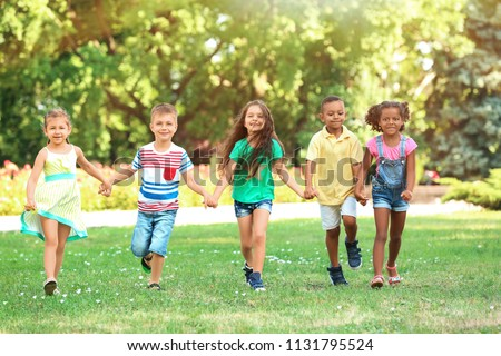 Cute little children playing in park #1131795524