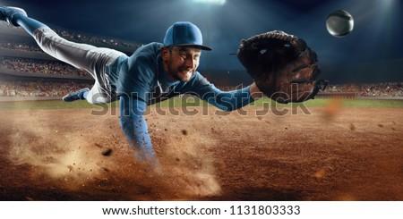 Baseball shortstop catches the ball on professional baseball stadium #1131803333