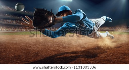 Baseball shortstop catches the ball on professional baseball stadium #1131803336