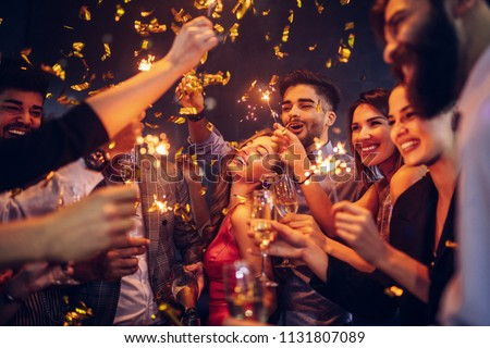 Group of friends celebrating at a nightclub #1131807089