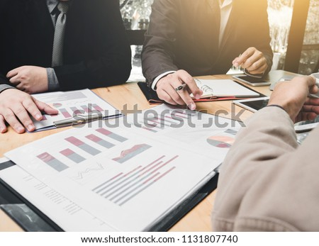 Meeting of tax lawyer business man and company president to discuss the problem of taxation on SMEs, teamwork, working together concept. #1131807740