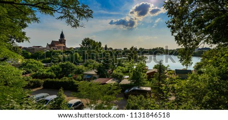 "Evening skyline of Waren/Mueritz with the tower of ""St. Marien"" (""St. Mary's Church""), view from the southern end of the ""Tiefenwarensee"" - Panorama from 5 pictures"