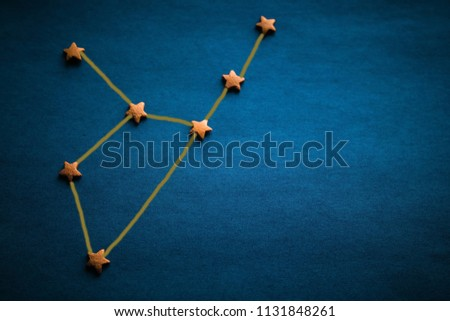 Gold stars on a blue background. Constellation Virgo, the sign of the zodiac. Prediction by date of birth. Daylighting, vignetting. The picture was made by the author.