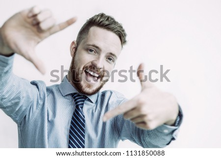 Closeup portrait of cheerful young business man looking at camera and making frame gesture. Isolated front view on white background. #1131850088