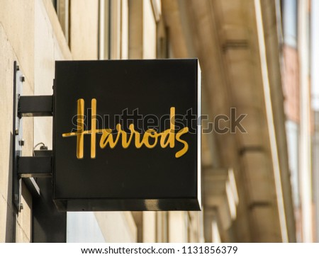 LONDON, ENGLAND - JUNE 2018: Sign above the office of Harrods Luxury Property Agents on Park Lane in central London #1131856379
