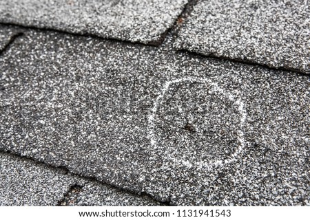Hail damage on roof after hailstorm #1131941543
