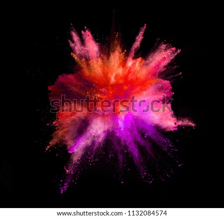 Explosion of coloured powder isolated on black background #1132084574