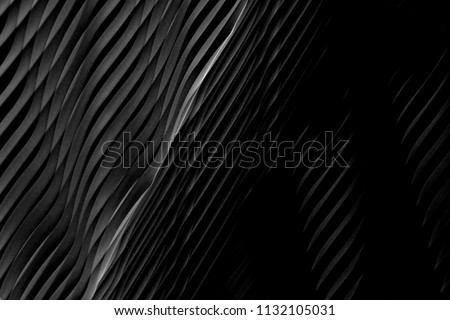 Wavy dark gray texture. Reworked close-up photo of wall surface. Grunge abstract black and white background on the subject of modern interior, architecture or technology.