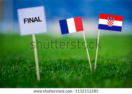 "FRANCE and CROATIA national Flag on football green grass. White table with tittle ""FINAL"" FINAL OF FIFA World Cup, Russia 2018 #1132112285"