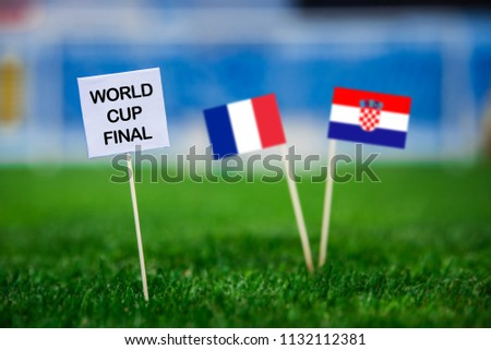 """FRANCE and CROATIA national Flag on football green grass. White table with tittle """"WORLD CUP FINAL"""" France - Croatia, FINAL OF fifa World Cup, Russia 2018   #1132112381"""