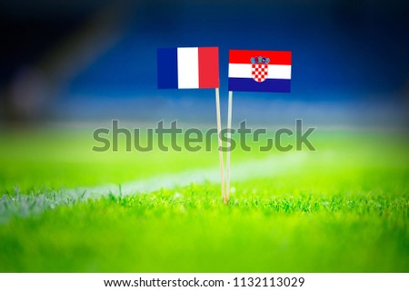 FRANCE and CROATIA national Flag on football green grass. France - Croatia, FINAL OF World Cup, Russia 2018  #1132113029