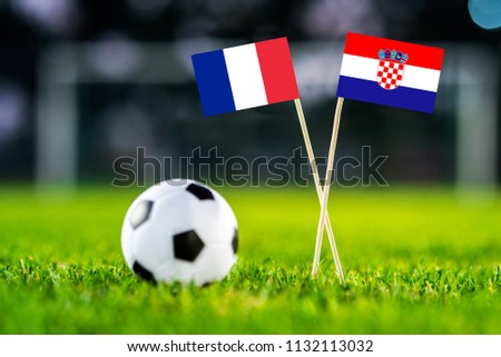 FRANCE and CROATIA national Flag on football green grass. France - Croatia, FINAL OF World Cup, Russia 2018 #1132113032