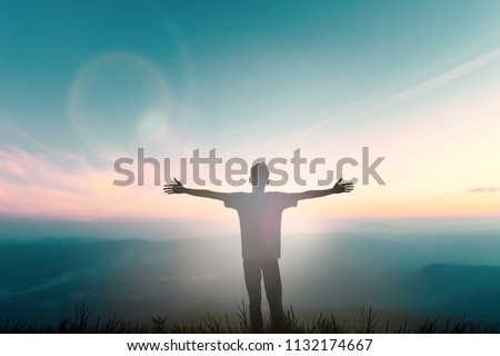 Happy man rise hand on morning view. Christian inspire praise God on good friday background. Now one man self confidence on peak open arms enjoying nature the sun concept world wisdom fun hope #1132174667