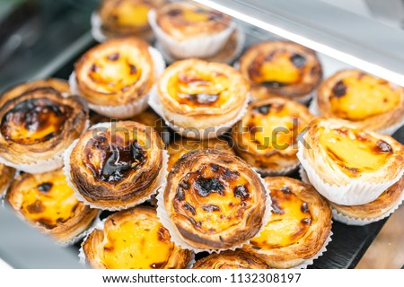 Rows of egg tart, traditional portuguese dessert, pasteis de nata, custard tarts. Cafe on the streets of Lisbon, Portugal #1132308197