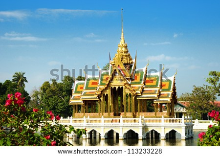 Small beautiful Buddhist temple in Thailand in winter day with light clouds #113233228