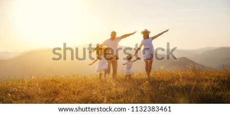 Happy family: mother, father, children son and  daughter on nature  on sunset #1132383461