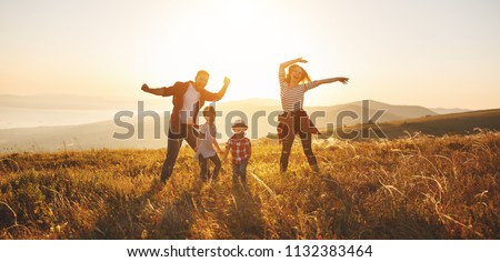 Happy family: mother, father, children son and  daughter on nature  on sunset #1132383464