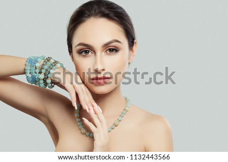 Pretty Young Woman with Makeup, Manicure Jewelry Bracelet and Necklace #1132443566