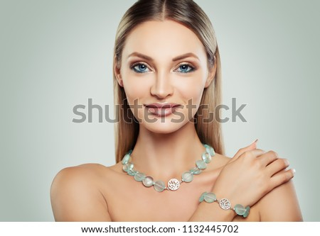 Smiling Woman Fashion Model with Makeup and Jewelry. Silver Necklace and Bracelet with Semiprecious Stones #1132445702