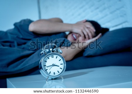young beautiful hispanic woman at home bedroom lying in bed late at night trying to sleep suffering insomnia sleeping disorder or scared on nightmares looking sad worried in mental health concept Royalty-Free Stock Photo #1132446590