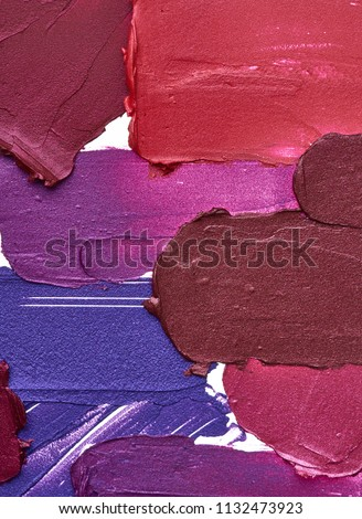 Smears of different colors are made with various lip gloss isolated on a white background. Texture of multi-colored strokes of various make-up cosmetics on a white background #1132473923