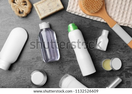 Flat lay composition with deodorant and toiletries on grey background #1132526609