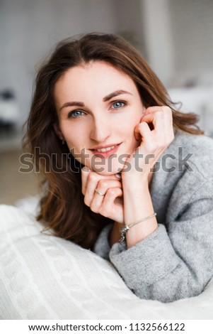 Beautiful girl with a brown-haired woman in a light gray interior. Close-up. #1132566122