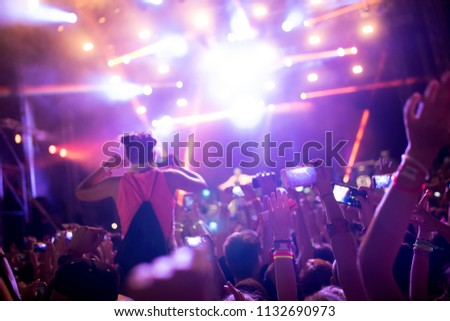 Portrait of happy crowd enjoying at music festival #1132690973
