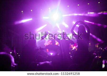 Portrait of happy crowd enjoying at music festival #1132691258