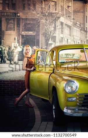 Dnipro / Ukraine - 08/08/2015: woman and retro car at old cars exhibition #1132700549