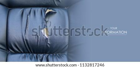 Torn car seat black leather ruptured foam rubber #1132817246