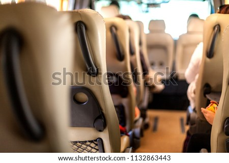 Transportation of people in a minibus #1132863443