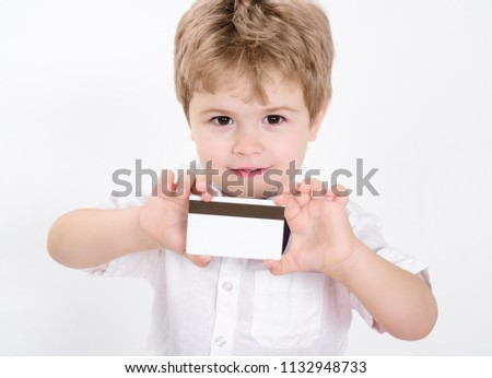 Boy showing blank credit card. Credit card. Cash card. Business-card. Copy space for bank advertising. Plastic bank-card with magstripe. Empty credit card. Cashless calculation. Bank concept.