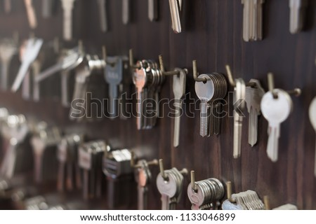 Several Keys type such as household and car key use for copying or duplicating hang on the wall in the locksmith workshop #1133046899
