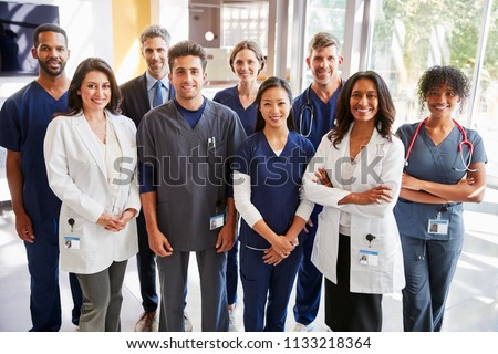 Team of healthcare workers at a hospital smiling to camera Royalty-Free Stock Photo #1133218364