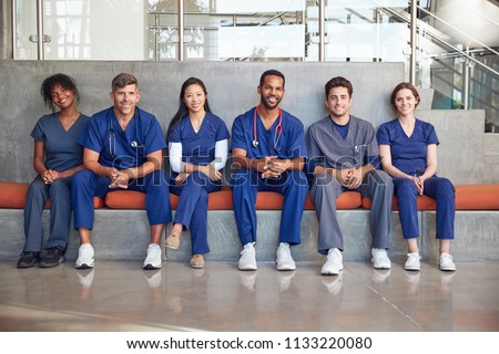Healthcare workers sitting in a modern hospital, low angle Royalty-Free Stock Photo #1133220080