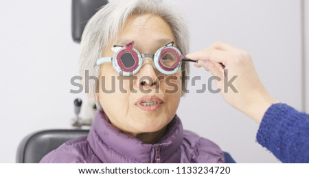 Senior woman having her eyes examine  #1133234720