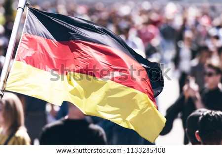 Crowd of People as Background and Flag of Germany #1133285408