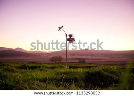 Weather station in field on farm #1133298059