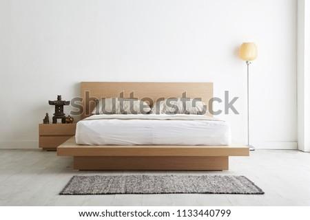 Modern peaceful Bedroom. zen style bedroom. Peaceful and serene bedroom. Wood bed with oriental object. japanese style bedroom.Deep sleep. meditation. #1133440799