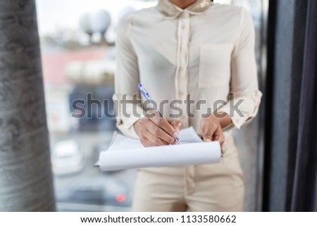 A serious woman with papers #1133580662