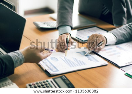 businessman working on desk office with using a calculator to calculate the numbers, finance accounting concept #1133638382