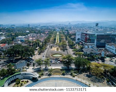 Bandung, West Java / Indonesia - July 7, 2018: Aerial View of Gasibu Field, after got renovated, with Monumen Perjuangan Rakyat Jawa Barat in The Background, Bandung, West Java, Indonesia, Asia #1133753171