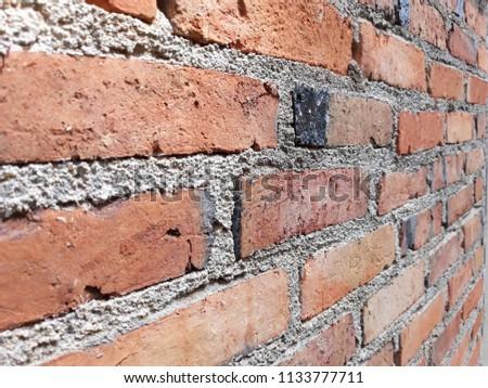 Muang, Trang / Thailand : 07 14 2018: Bricks Vintage Brown Wall Background of Taxtures #1133777711