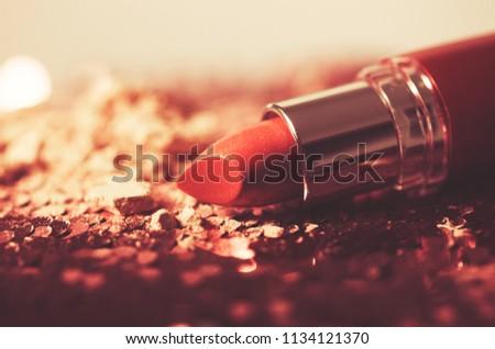 Creative concept photo of cosmetics lipsticks on black background. #1134121370