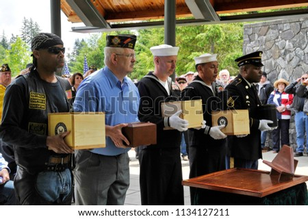 Port Orchard, Washington / USA - May 24, 2014: Kitsap County  Veterans Board and community members escorting unclaimed and other cremains of veterans to the Tahoma National Cemetery, May 24, 2014. #1134127211