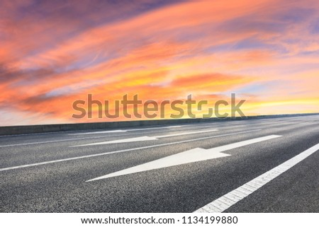 New asphalt road and beautiful sky clouds at sunrise #1134199880
