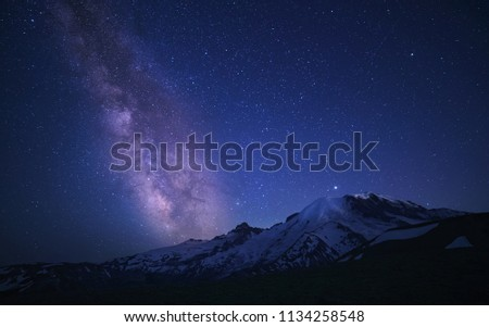 Milky Way Over Mount Rainier shot along the Burroughs Mountain Trail With Climbers Lights/Torch visible halfway up the mountain #1134258548