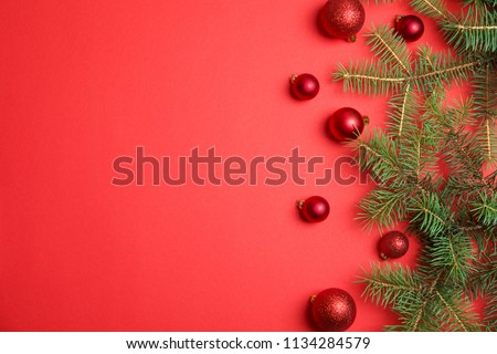 Flat lay composition with Christmas tree branches and festive decor on color background #1134284579